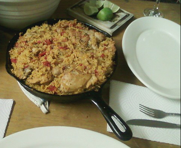 Arroz con Pollo served with a Green Salad