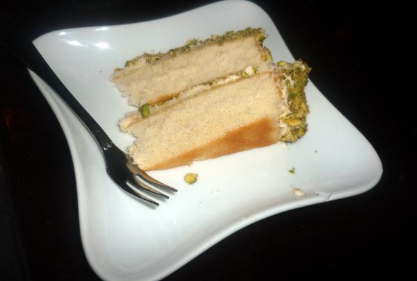 Birthday Cake Slice with Mango Cream Cheese Icing and Pistachio Crumb